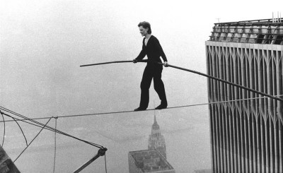 Philippe Petit, a French high wire artist, walks across a tightrope suspended between the World Trade Center's Twin Towers. New York, Aug. 7, 1974. (AP Photo/Alan Welner)